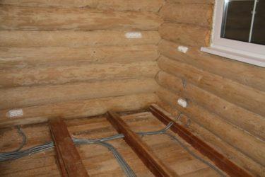 Скрытая проводка в доме из бруса